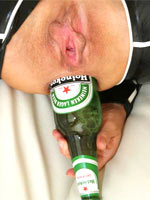 Beer bottle in the ass