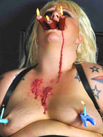 Wax play and facial torture